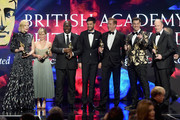 (L-R) Stanley Kubrick Britannia Award for Excellence in Film presented by Cunard winner Cate Blanchett, Britannia Award for British Artist of the Year winner Emilia Clarke, John Schlesinger Britannia Award for Excellence in Directing winner Steve McQueen, Britannia Award for Excellence in Television winner Damian Lewis, Charlie Chaplin Britannia Award for Excellence in Comedy presented by Jaguar Land Rover winner Jim Carrey, and Albert R. Broccoli Britannia Award for Worldwide Contribution to Entertainment winner and President of Marvel Studios Kevin Feige accept their awards onstage during the 2018 British Academy Britannia Awards presented by Jaguar Land Rover and American Airlines at The Beverly Hilton Hotel on October 26, 2018 in Beverly Hills, California.