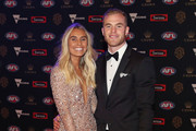 Tom Mitchell of the Hawks poses with his partner Hannah Davis as they arrive ahead of the 2018 Brownlow Medal at Crown Entertainment Complex on September 24, 2018 in Melbourne, Australia.