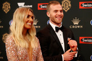 Tom Mitchell of the Hawks arrives with partner Hannah Davis during the 2018 Swisse Brownlow Red Carpet arrivals at Crown Palladium on September 24, 2018 in Melbourne, Australia.