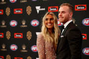 Tom Mitchell of the Hawks and partner Hannah Davis arrive during the 2018 Swisse Brownlow Red Carpet arrivals at Crown Palladium on September 24, 2018 in Melbourne, Australia.