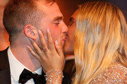2018 Brownlow Medallist Tom Mitchell of the Hawks and partner Hannah Davis celebrate during the 2018 Brownlow Medal Count at Crown Palladium on September 24, 2018 in Melbourne, Australia.