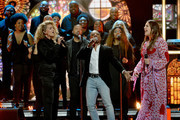 (L-R) Tori Kelly, Kirk Franklin and Hillary Scott onstage during the 2018 CMT Artists of The Year at Schermerhorn Symphony Center on October 17, 2018 in Nashville, Tennessee.