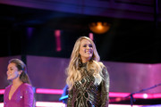 Tae Dye of musical duo Maddie and Tae (L) and Carrie Underwood perform onstage during the 2018 CMT Artists of The Year at Schermerhorn Symphony Center on October 17, 2018 in Nashville, Tennessee.