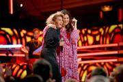 Tori Kelly (L) and Hillary Scott onstage during the 2018 CMT Artists of The Year at Schermerhorn Symphony Center on October 17, 2018 in Nashville, Tennessee.