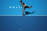 Feliciano Lopez of Spain hits a return against Borna Coric of Croatia during their Men's Singles 1nd Round match of the 2018 China Open at the China National Tennis Centre on October 1, 2018 in Beijing, China.