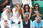 Rafael Nadal's mother Ana Maria Parera, sister, Maria Isabel Nadal and girlfriend, Xisca Perello watch on during his mens singles quarter finals match against Diego Schwartzman of Argentina during day eleven of the 2018 French Open at Roland Garros on June 6, 2018 in Paris, France.