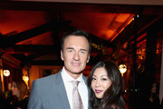 Julian McMahon (L) and Brittany Ishibashi attend the 2018 Hulu Holiday Party at Cecconi's Restaurant on November 16, 2018 in Los Angeles, California.