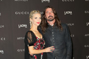 Jordyn Blum (L) and recording artist Dave Grohl attend 2018 LACMA Art + Film Gala honoring Catherine Opie and Guillermo del Toro presented by Gucci at LACMA on November 3, 2018 in Los Angeles, California.