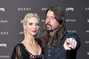 Jordyn Blum (L) and Dave Grohl attend 2018 LACMA Art + Film Gala honoring Catherine Opie and Guillermo del Toro presented by Gucci at LACMA on November 3, 2018 in Los Angeles, California.