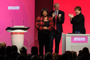 Shadow Home Secretary Diane Abbott (L) is applauded by Labour Party leader Jeremy Corbyn (C) and Shadow Foreign Secretary Emily Thornberry (R) after addressing delegates in the Exhibition Centre Liverpool, during day three of the annual Labour Party conference, on September 25, 2018 in Liverpool, England. Labour's official slogan for the conference is 'Rebuilding Britain, for the many, not the few.'