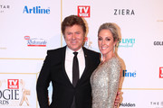 Richard Wilkins and Virginia Burmeister arrives at the 60th Annual Logie Awards at The Star Gold Coast on July 1, 2018 in Gold Coast, Australia.