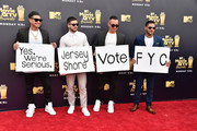 (L-R) TV personalities Paul DelVecchio aka DJ Pauly D, Vinny Guadagnino, Mike Sorrentino aka The Situation, and Ronnie Ortiz-Magro attend the 2018 MTV Movie And TV Awards at Barker Hangar on June 16, 2018 in Santa Monica, California.