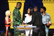 (L-R) Recording artist Lady Gaga, actor Winston Duke, host Tiffany Haddish, actor Michael B. Jordan, and actor Chadwick Boseman speak after 'Black Panther' won the Best Movie award (Presented by Toyota) onstage during the 2018 MTV Movie And TV Awards at Barker Hangar on June 16, 2018 in Santa Monica, California.