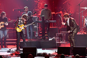 Recording artists Wayne Sermon (L) and Dan Reynolds of music group Imagine Dragons perform onstage during MusiCares Person of the Year honoring Fleetwood Mac at Radio City Music Hall on January 26, 2018 in New York City.