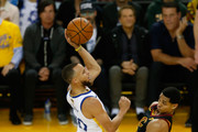 Stephen Curry #30 of the Golden State Warriors shoots over Jordan Clarkson #8 of the Cleveland Cavaliers in Game 1 of the 2018 NBA Finals at ORACLE Arena on May 31, 2018 in Oakland, California. NOTE TO USER: User expressly acknowledges and agrees that, by downloading and or using this photograph, User is consenting to the terms and conditions of the Getty Images License Agreement.