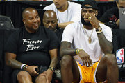 Randy Mims (L) and LeBron James of the Los Angeles Lakers laugh as they attend a quarterfinal game of the 2018 NBA Summer League between the Lakers and the Detroit Pistons at the Thomas & Mack Center on July 15, 2018 in Las Vegas, Nevada. NOTE TO USER: User expressly acknowledges and agrees that, by downloading and or using this photograph, User is consenting to the terms and conditions of the Getty Images License Agreement.