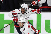 Andre Burakovsky #65 and Devante Smith-Pelly #25 of the Washington Capitals clear the bench to celebrate their 4-3 win over the Vegas Golden Knights to win the Stanley Cup in Game Five of the 2018 NHL Stanley Cup Final at T-Mobile Arena on June 7, 2018 in Las Vegas, Nevada.