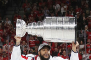Devante Smith-Pelly #25 of the Washington Capitals carries the Stanley Cup in celebration after his team defeated the Vegas Golden Knights 4-3 in Game Five of the 2018 NHL Stanley Cup Final at the T-Mobile Arena on June 7, 2018 in Las Vegas, Nevada.