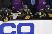 (L-R) Alex Tuch #89, Tomas Tatar #90 and William Carrier #28 of the Vegas Golden Knights sit on the bench as they watch the Washington Capitals celebrate their 4-3 win in Game Five of the 2018 NHL Stanley Cup Final at T-Mobile Arena on June 7, 2018 in Las Vegas, Nevada.