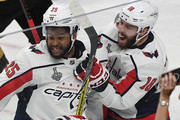 Devante Smith-Pelly #25 and Chandler Stephenson #18 of the Washington Capitals celebrate after Smith-Pelly scored a third-period goal against the Vegas Golden Knights in Game Five of the 2018 NHL Stanley Cup Final at T-Mobile Arena on June 7, 2018 in Las Vegas, Nevada. The Capitals defeated the Golden Knights 4-3.
