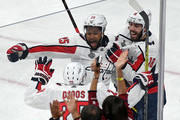 Devante Smith-Pelly #25 of the Washington Capitals celebrates with teammates Christian Djoos #29 and Chandler Stephenson #18 after scoring a third-period goal against the Vegas Golden Knights in Game Five of the 2018 NHL Stanley Cup Final at T-Mobile Arena on June 7, 2018 in Las Vegas, Nevada. The Capitals defeated the Golden Knights 4-3.