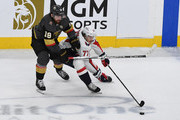 T.J. Oshie #77 of the Washington Capitals is defended by James Neal #18 of the Vegas Golden Knights during the second period in Game Five of the 2018 NHL Stanley Cup Final at T-Mobile Arena on June 7, 2018 in Las Vegas, Nevada. The Capitals defeated the Golden Knights 4-3.