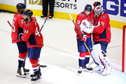Devante Smith-Pelly #25, Brooks Orpik #44, Christian Djoos #29 and Braden Holtby #70 of the Washington Capitals celebrate their team's 6-2 win over the Vegas Golden Knights in Game Four of the 2018 NHL Stanley Cup Final at Capital One Arena on June 4, 2018 in Washington, DC.