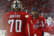 Alex Ovechkin #8 and Braden Holtby #70 of the Washington Capitals celebrate after a first-period goal by teammate Devante Smith-Pelly (not pictured) against the Vegas Golden Knights in Game Four of the 2018 NHL Stanley Cup Final at Capital One Arena on June 4, 2018 in Washington, DC.