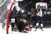 Marc-Andre Fleury #29 stops a shot as Shea Theodore #27 of the Vegas Golden Knights and Jakub Vrana #13 of the Washington Capitals get tangled up after the whistle during the first period in Game Two of the 2018 NHL Stanley Cup Final at T-Mobile Arena on May 30, 2018 in Las Vegas, Nevada.