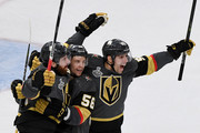 (L-R) James Neal #18 of the Vegas Golden Knights celebrates with teammates Erik Haula #56 and David Perron #57 after Neal scored a goal against the Washington Capitals in the first period of Game Two of the 2018 NHL Stanley Cup Final at T-Mobile Arena on May 30, 2018 in Las Vegas, Nevada. The Capitals defeated the Golden Knights 3-2.