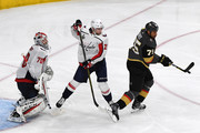 Ryan Reaves #75 of the Vegas Golden Knights tries to tip the puck into the net past Christian Djoos #29 and Braden Holtby #70 of the Washington Capitals in the third period of Game Two of the 2018 NHL Stanley Cup Final at T-Mobile Arena on May 30, 2018 in Las Vegas, Nevada. The Capitals defeated the Golden Knights 3-2.
