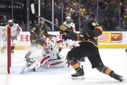 Braden Holtby #70 of the Washington Capitals makes a diving stick-save on Alex Tuch #89 of the Vegas Golden Knights during the third period in Game Two of the 2018 NHL Stanley Cup Final at T-Mobile Arena on May 30, 2018 in Las Vegas, Nevada.