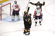 James Neal #18 of the Vegas Golden Knights is congratulated by his teammates Erik Haula #56 and David Perron #57 after scoring a first-period goal as Braden Holtby #70 and Michal Kempny #6 of the Washington Capitals react in Game Two of the 2018 NHL Stanley Cup Final at T-Mobile Arena on May 30, 2018 in Las Vegas, Nevada.