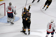 James Neal #18 of the Vegas Golden Knights is congratulated by his teammate Erik Haula #56 after scoring a first-period goal as Braden Holtby #70 and Michal Kempny #6 of the Washington Capitals react in Game Two of the 2018 NHL Stanley Cup Final at T-Mobile Arena on May 30, 2018 in Las Vegas, Nevada.