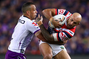 Blake Ferguson of the Roosters is tackled by Will Chambers of the Storm during the 2018 NRL Grand Final match between the Melbourne Storm and the Sydney Roosters at ANZ Stadium on September 30, 2018 in Sydney, Australia.