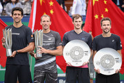 (L-R) Lukasz Kubot of Poland and Marcelo Melo of Brazil, Jamie Murray of Great Britain and Bruno Soares of Brazil pose with their trophy after the Men's doubles final match on day 8 of 2018 Shanghai Rolex Masters at Qi Zhong Tennis Centre on October 14, 2018 in Shanghai, China.