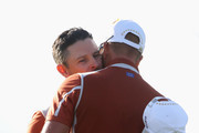 Justin Rose of Europe and Henrik Stenson of Europe celebrate during the afternoon foursome matches of the 2018 Ryder Cup at Le Golf National on September 29, 2018 in Paris, France.