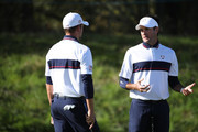 Webb Simpson (L) of the United States and Bubba Watson of the United States talk during practice ahead of the 2018 Ryder Cup at Le Golf National on September 25, 2018 in Paris, France.