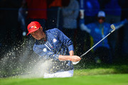 Rickie Fowler of the United States plays out of a bunker during singles matches of the 2018 Ryder Cup at Le Golf National on September 30, 2018 in Paris, France.