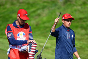 Rickie Fowler of the United States and caddie Joe Skovron during singles matches of the 2018 Ryder Cup at Le Golf National on September 30, 2018 in Paris, France.