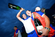 Henrik Stenson of Europe poors Champagne over Thorbjorn Olesen of Europe as they celebrate winning The Ryder Cup during singles matches of the 2018 Ryder Cup at Le Golf National on September 30, 2018 in Paris, France.
