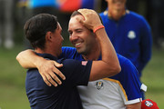 Rickie Fowler of the United States congratulates Sergio Garcia of Europe on victory during singles matches of the 2018 Ryder Cup at Le Golf National on September 30, 2018 in Paris, France.