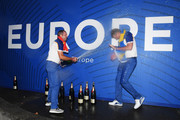Sergio Garcia of Europe sprays champagne over Henrik Stenson of Europe after they win The Ryder Cup following singles matches of the 2018 Ryder Cup at Le Golf National on September 30, 2018 in Paris, France.
