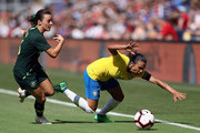 Marta #10 of Brazil is pushed to the ground by Hayley Raso #16 of Australia during their Tournament of Nations match at Children's Mercy Park on July 26, 2018 in Kansas City, Kansas.