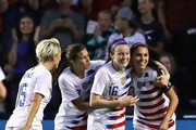 (L-R) Megan Rapinoe #15, Tobin Heath #17, Rose Lavelle #16 and Alex Morgan #13 of the United States celebrate Lavells goal against Brazil during the 2018 Tournament Of Nations at Toyota Park on August 2, 2018 in Bridgeview, Illinois.