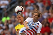 Tobin Heath #17 of the United States and Tamires #6 of Brazil battle for a header during the 2018 Tournament Of Nations at Toyota Park on August 2, 2018 in Bridgeview, Illinois.