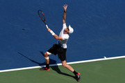 Jamie Murray of Great Britain and partner Bruno Soares of Brazil (Not pictured) serves during their men's doubles quarter-final match against Malek Jaziri of Tunisia and Radu Albot of Moldova on Day Ten of the 2018 US Open at the USTA Billie Jean King National Tennis Center on September 5, 2018 in the Flushing neighborhood of the Queens borough of New York City.