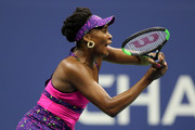 Venus Williams of the United States returns the ball during her women's singles third round match against Serena Williams of the United States on Day Five of the 2018 US Open at the USTA Billie Jean King National Tennis Center on August 31, 2018 in the Flushing neighborhood of the Queens borough of New York City.