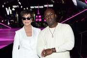 Kris Jenner and Corey Gamble attend the 2018 Victoria's Secret Fashion Show in New York at Pier 94 on November 8, 2018 in New York City.