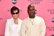 Kris Jenner and Corey Gamble attend the Victoria's Secret Fashion Show at Pier 94 on November 8, 2018 in New York City.